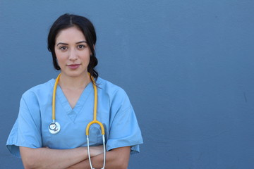 Stock image of female health care worker isolated on blue background