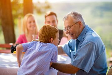 Grandfather and grandson having fun.