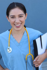Attractive Female Hispanic Doctor or Nurse Isolated on a Blue Background