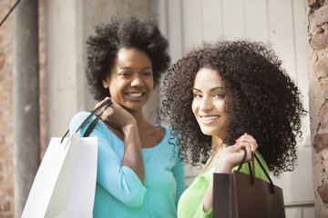 African american friends with shopping bags
