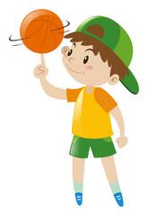 Boy spinning basketball on finger