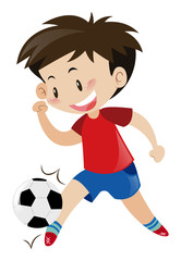 Boy in red shirt playing football
