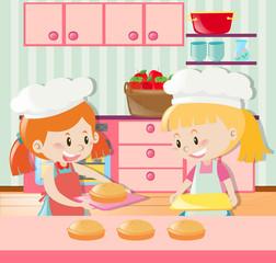 Two girls making pie in kitchen