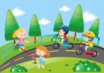 Children racing bike in the park