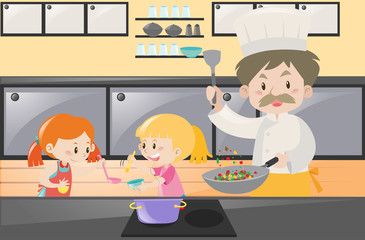 Girls and chef cooking in kitchen