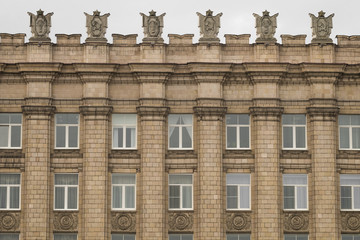 Fragment of facade building administrative government Belgorod region with USSR symbols. Ornament of Stalinist architecture style.  Image ID:498531688