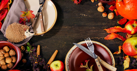 Autumn table setting with fruits and nuts.