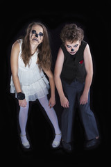 Portrait of a girl and a boy dressed for halloween celebration