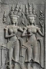 Stone bas relief facade, maidens, Angkor Wat, Siem Reap, Cambodia