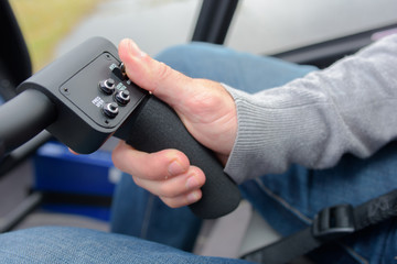 Hand on steering controls