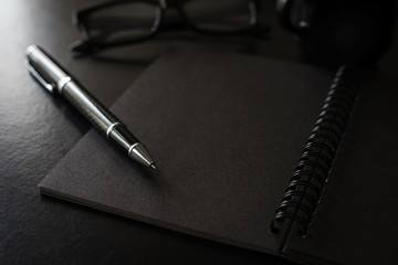 Black notebook with copyspace and cup of coffee