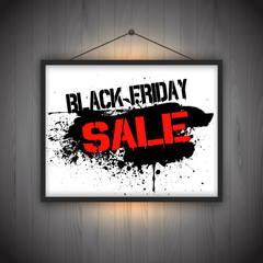 Black Friday sale background with hanging picture frame on wooden wall