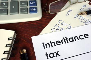 Inheritance tax written on a paper. Financial concept.