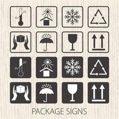 Vector packaging symbols on vector wooden background. Icon set including fragile, this side up, handle with care, keep dry and other caution handling symbols. Stock vector. Flat design.