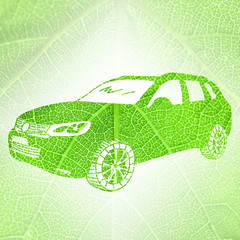 Silhouette of car on green leaf texture background. Eco-friendly transport concept.