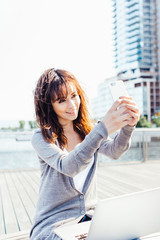Young Beautiful Woman Taking a Selfie in New York City