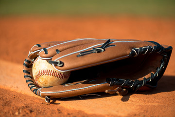 Baseball glove and ball on pitchers mound