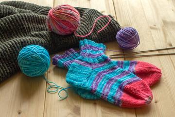 Knitted handmade baby socks, multicolor wool skeins