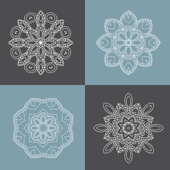 Four beautiful circular ornament on a colored background. Mandala. Ethnic.