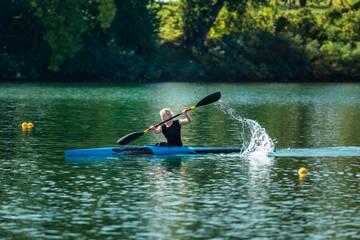 Kayak. Female kayaking champion in action