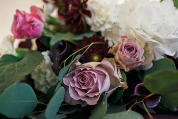 Beautiful purple rose in the wedding bouquet