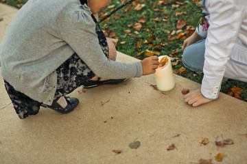 Children is playing with the white candle