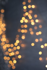 Defocused abstract multicolored bokeh lights background.