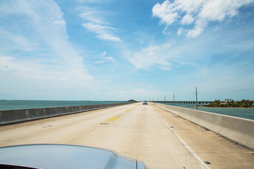 Beautiful endless road from Miami to Key West driving Ford Musta