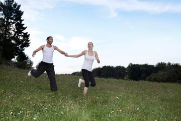 couple is running thru nature