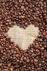 Brown roasted coffee beans on sackcloth