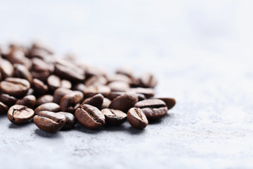 Roasted coffee beans on a grey table