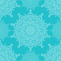 Seamless mandala snowflakes pattern. Winter theme festive wallpaper. White floral snowflakes on turquoise blue background.