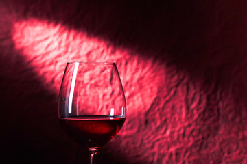 glass of red wine on a dark background