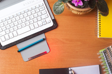 Office desk table with computer, supplies, flower. Copy space for text