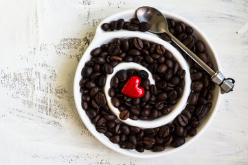 Coffee beans on rustic background