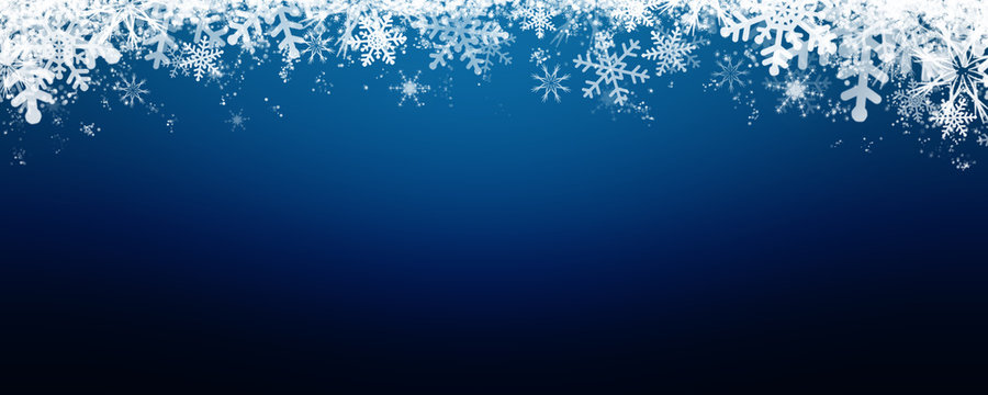 Blue winter background with snow and snowflackes.