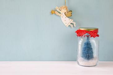 beautiful mason jar with christmas tree and flying angel