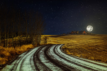 Winter landscape with country road, starry night sky and the moon