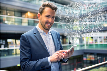 Young attractive business man using smartphone surrounded by ico