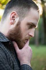 thoughtful young man with a beard