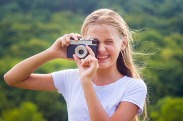 Happy little girl with Cameras