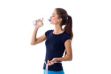 Woman with centimeter drinking water