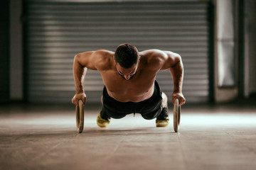 Doing push-ups by rings