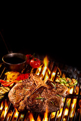 T bone steak on flaming grill with copy space