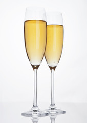 Glasses of sparkling champagne with bubbles white