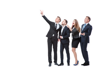 Just look at this! Full length of group of surprised and amazed business people looking and pointing away. Isolated on white.