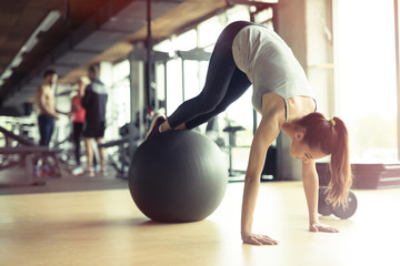 Athletic woman exercising in gym
