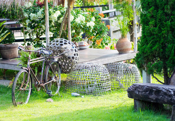 Old thai bikecycle on green grass