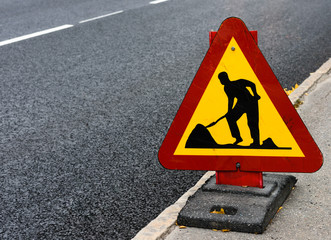 Roadwork sign at the side of a road