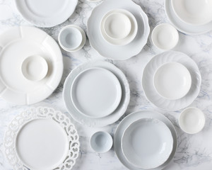White plates on marble table